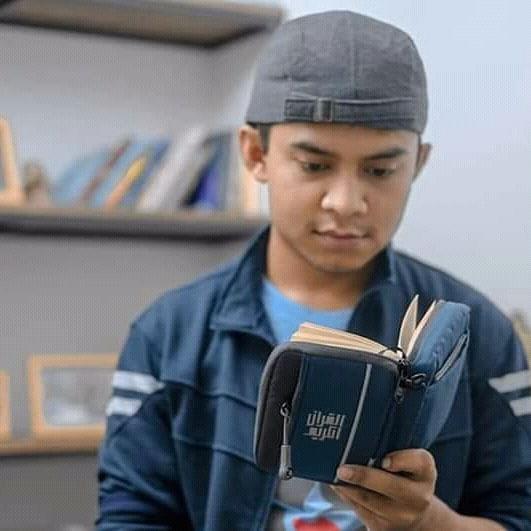Hukum Membaca Quran